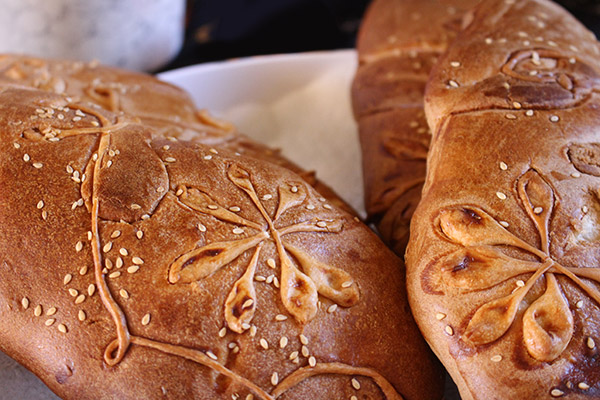 intricately decorated bread for communion